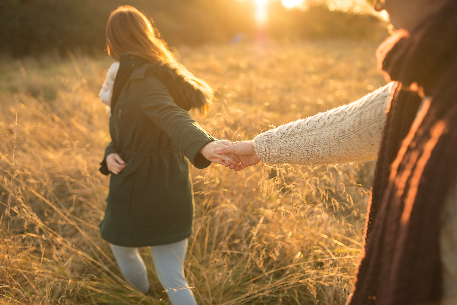 autumn-couple-hiking-together-sunset-long-grass-romance-leading-walk-epping-forest-london-uk-20