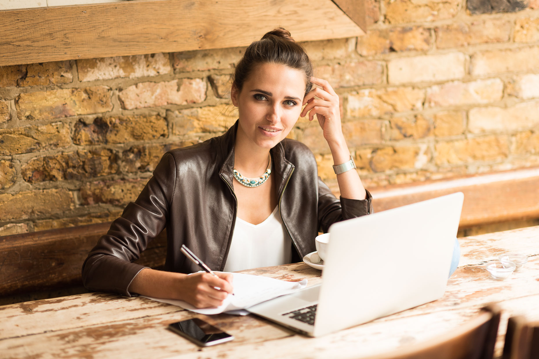beautiful-woman-sitting-working-laptop-cafe-notes-islington-london-business-photographer-10